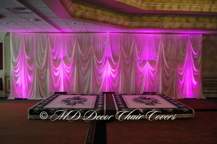 Ivory back drop with purple LED up lights