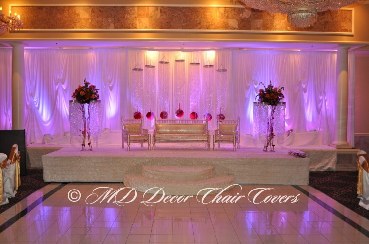 BACKDROP-WITH-THE-HANGING-CRYSTALS-AND-UPLIGHTS